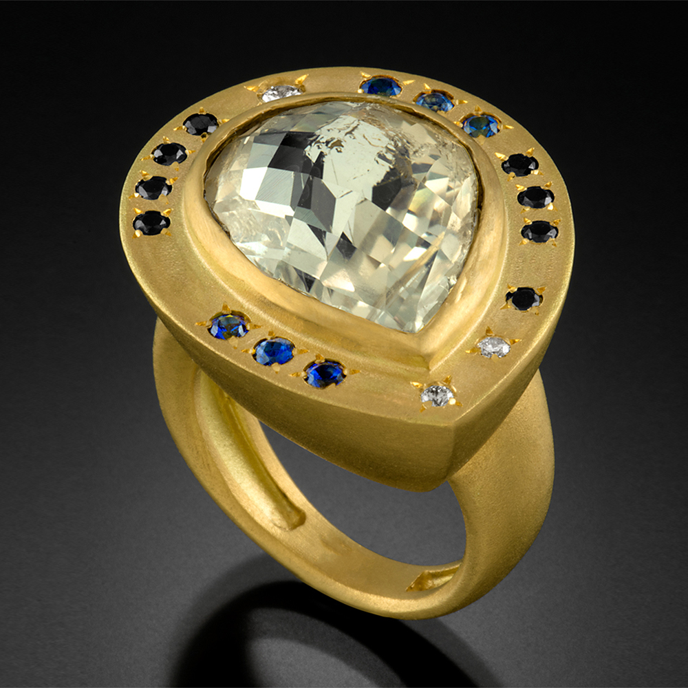 18K brushed gold ring with a bezel set faceted Moonstone