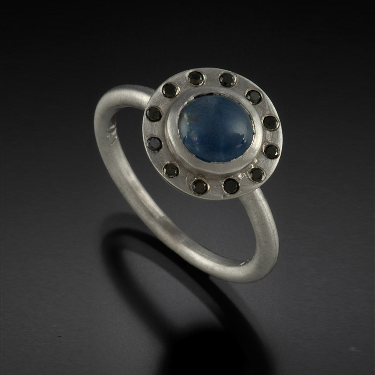 18K brushed white gold ring with blue star Sapphire