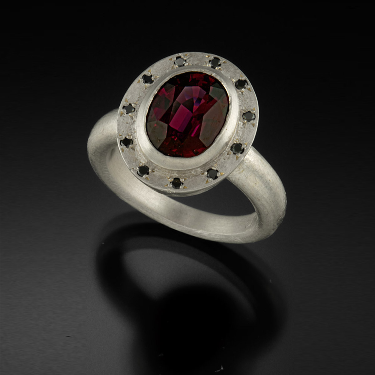 Brushed sterling silver ring with Rhodolite Garnet