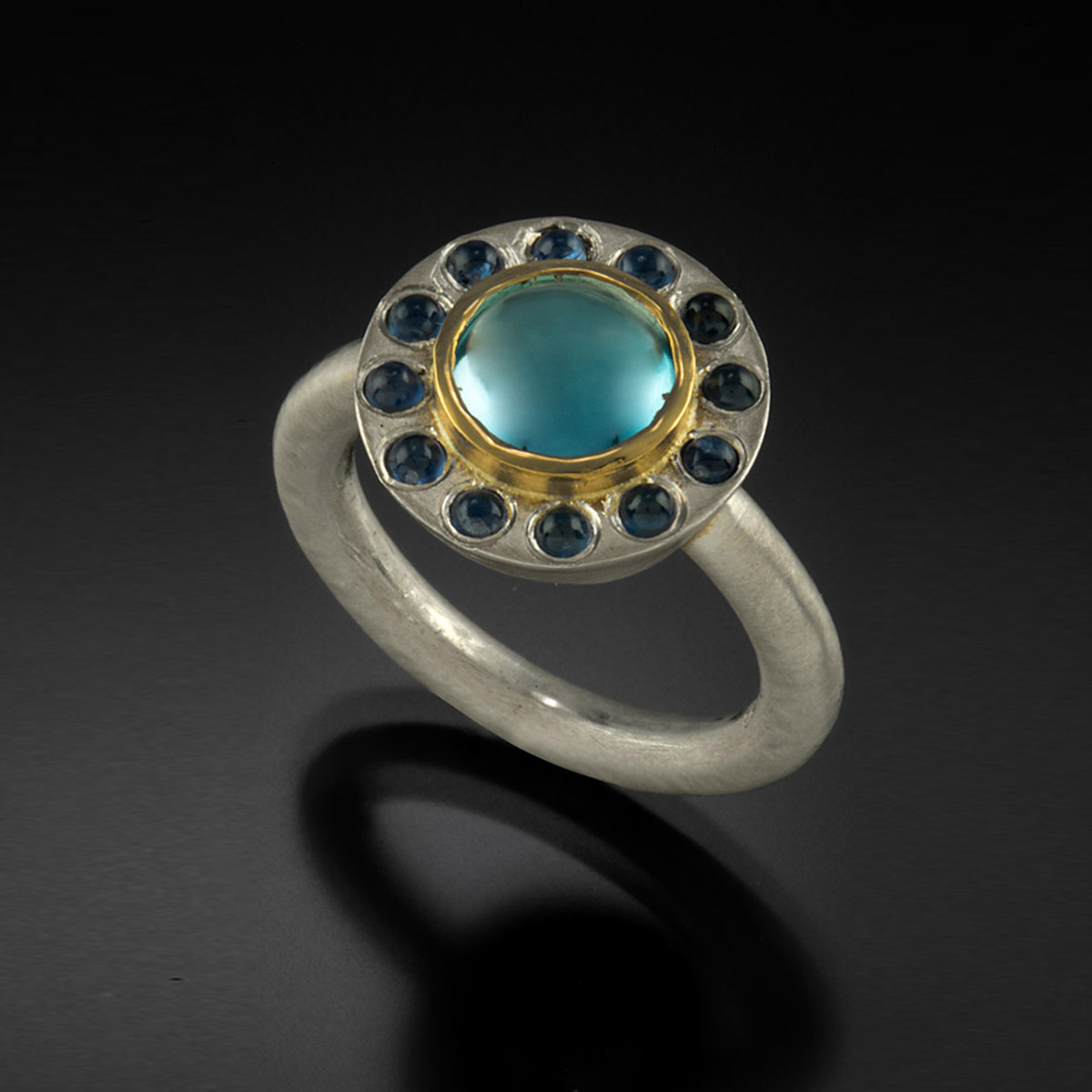 Brushed sterling silver and 18K yellow gold ring with blue Topaz