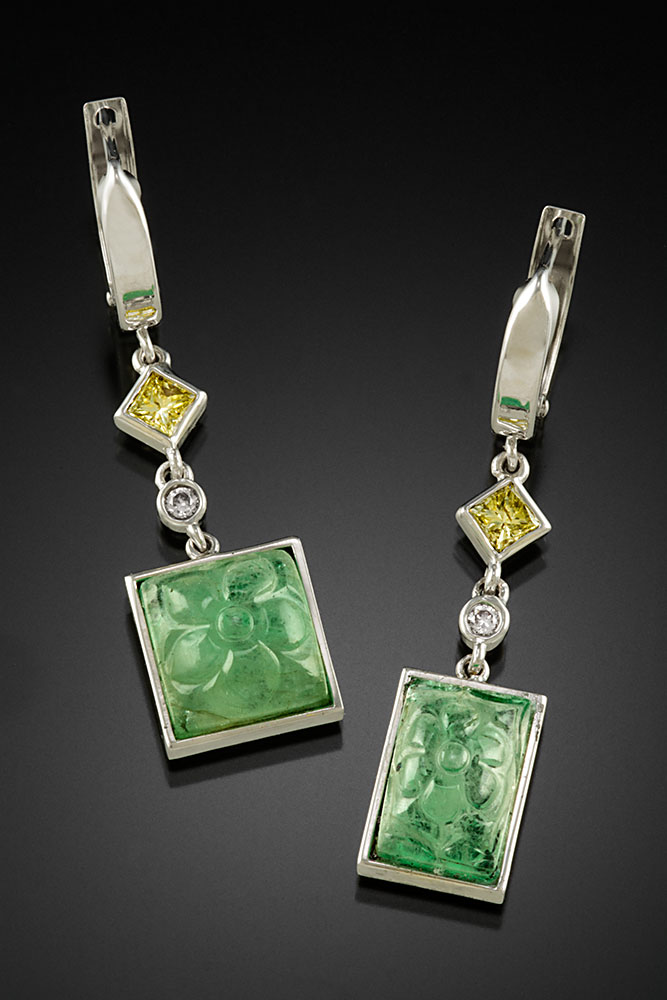 18K white gold dangle earrings with bezel set carved Emeralds, yellow and pink Diamonds