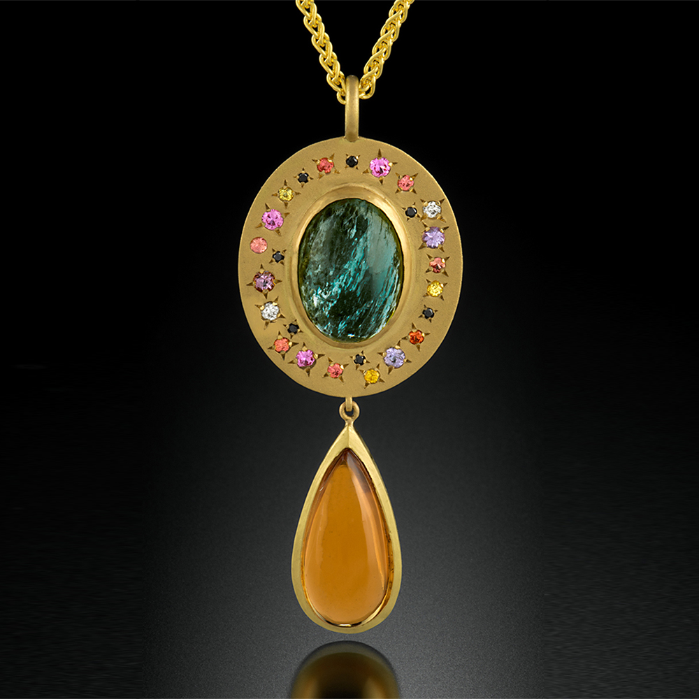 18K brushed yellow gold pendant with bezel set Aquamarine