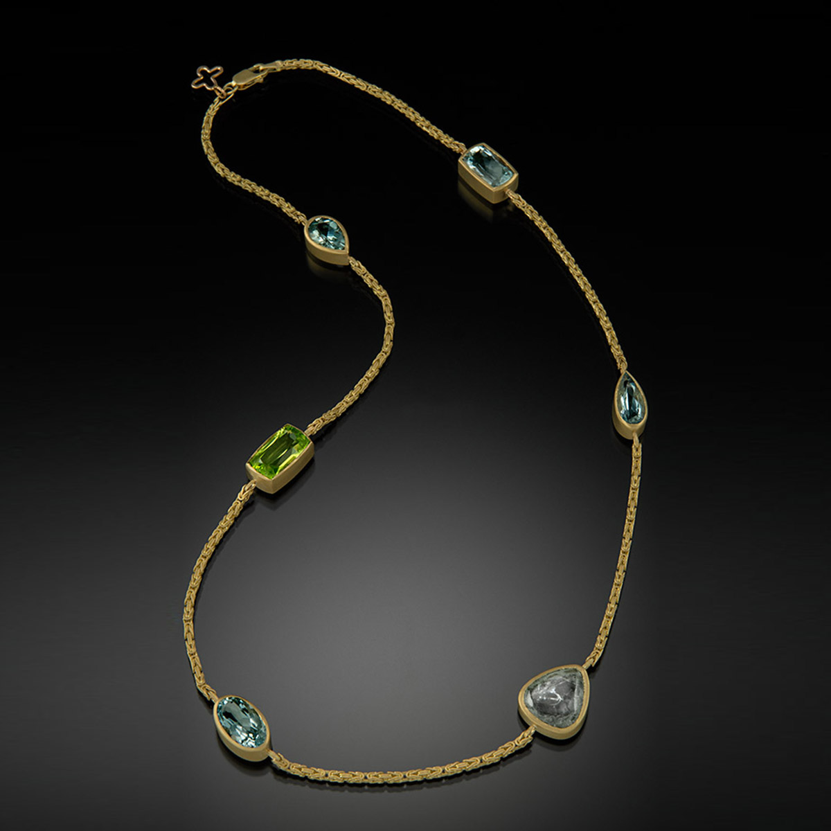 18K brushed yellow gold necklace with Aquamarine, Peridot and Tourmaline.
