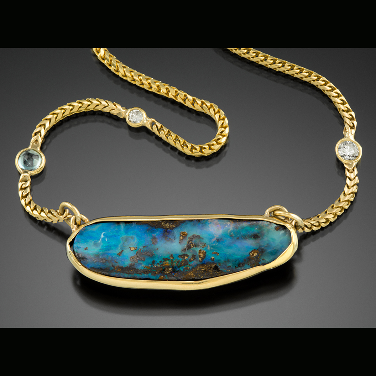 18K yellow gold necklace with Boulder Opal Diamonds and blue Topaz.