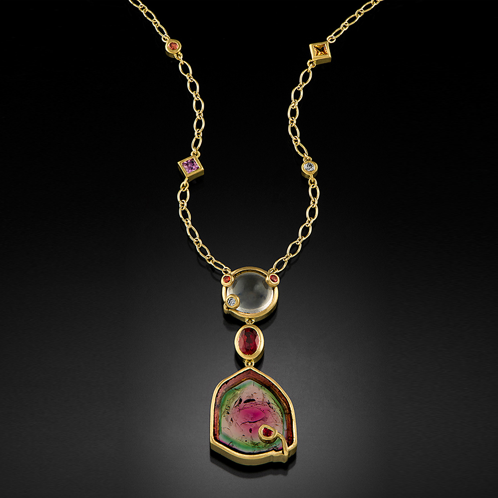 Brushed yellow gold necklace with a bezel set watermelon Tourmaline