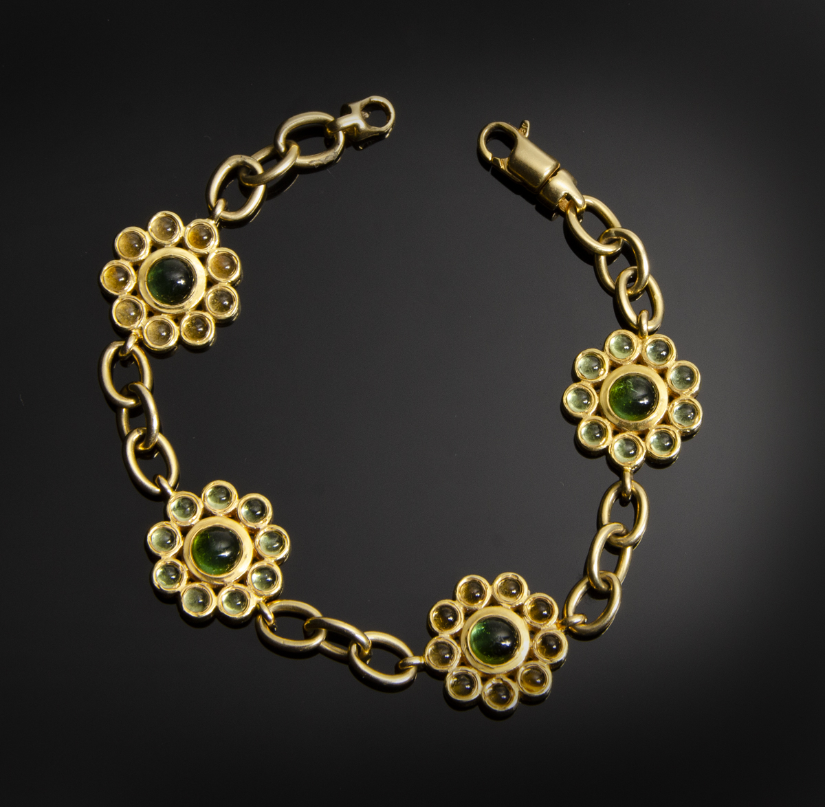 18K yellow gold flower bracelet with bezel set Tourmaline, Citrine and Peridot
