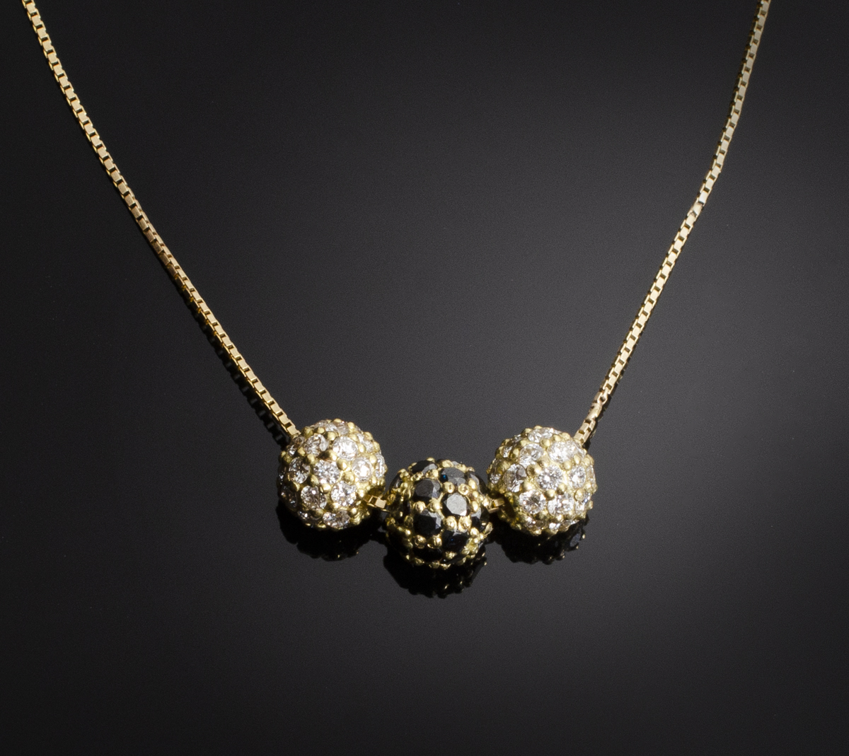 18K yellow gold bead necklace with pave beads of black and colorless Diamonds