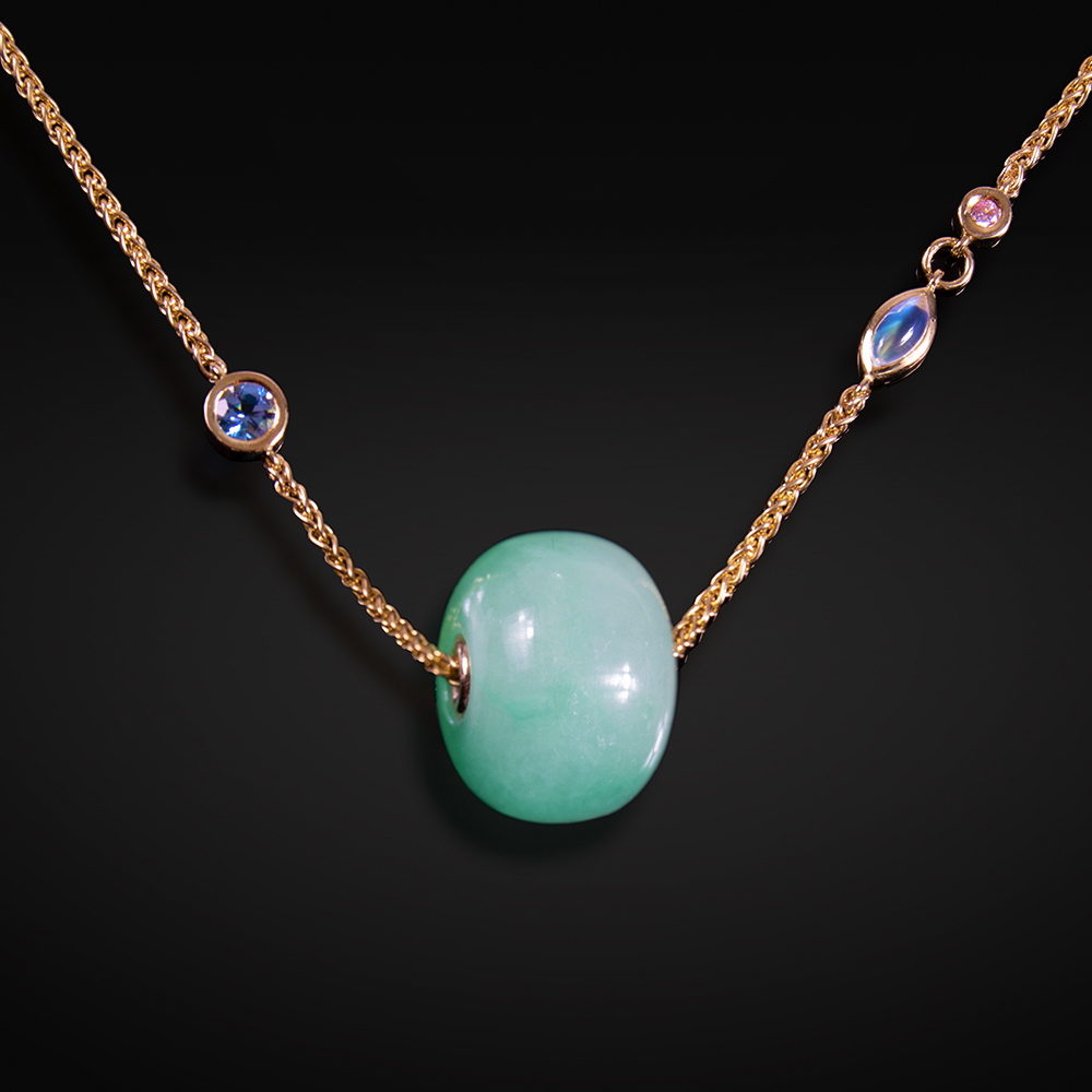 18K yellow gold necklace with Jade bead, containing Sapphire, Moonstone and Diamond within chain
