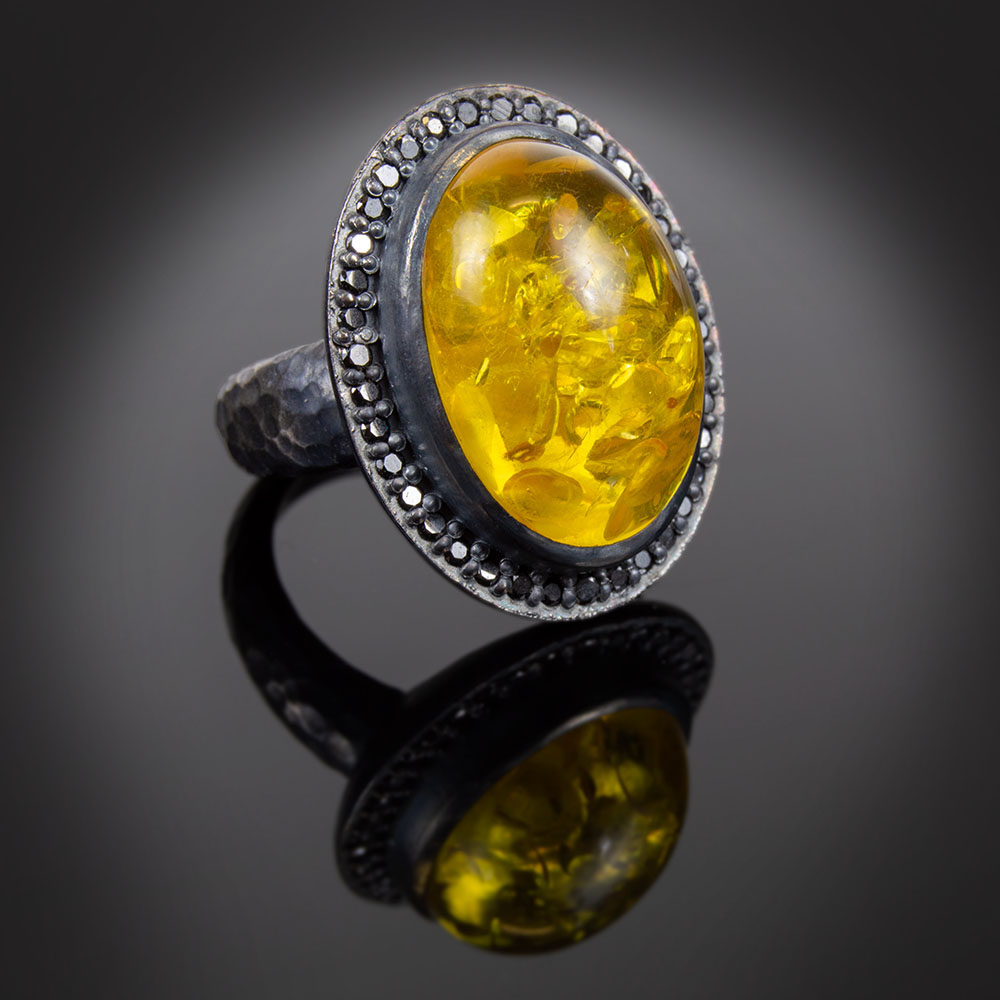 Oxidized and hammered sterling silver ring with Amber and black Diamonds