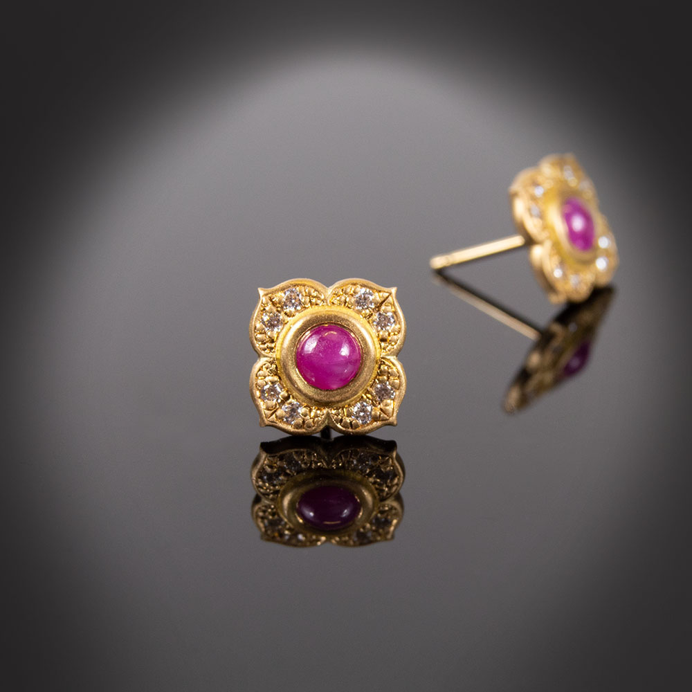 18K yellow gold flower stud earrings with Rubies and Diamonds.