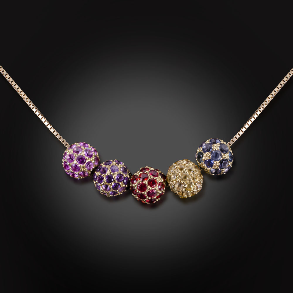 18K yellow gold necklace with blue and yellow Sapphire, red Spinel, and Sapphire