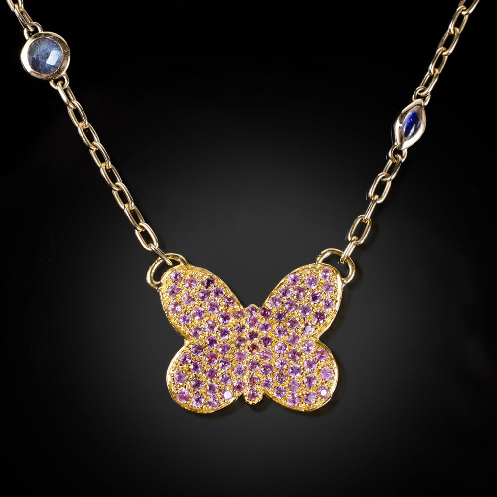 18K yellow gold butterfly necklace with flush set pink Sapphires