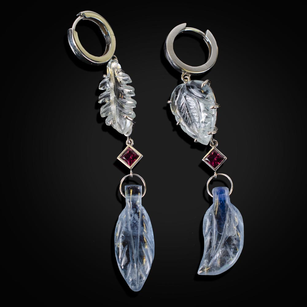 18K white gold dangle earrings with carved Aquamarine, Kyanite and a bezel set Rubies