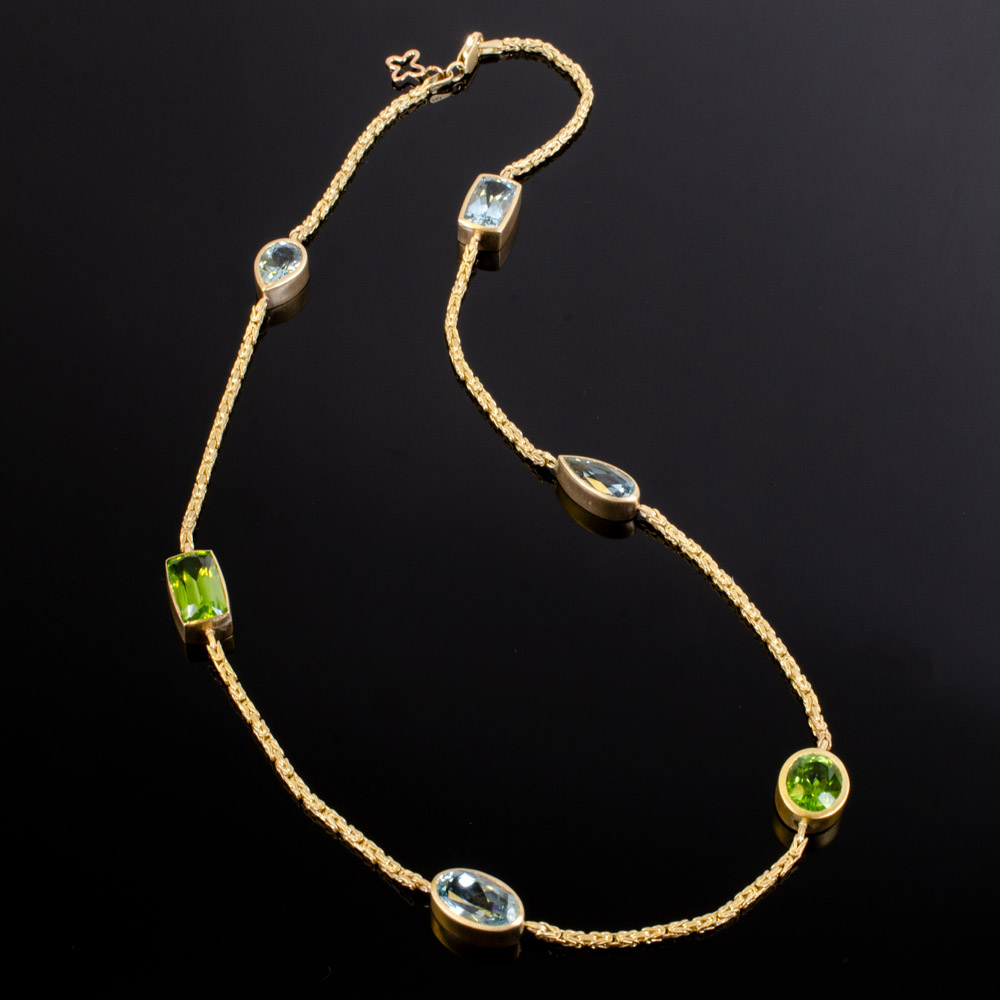 Brushed 18K necklace with bezel set Aquamarines and Peridots