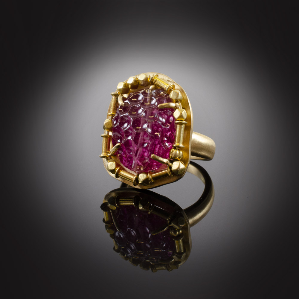18K brushed yellow gold ring with a 15.69 ct. carved pink Tourmaline