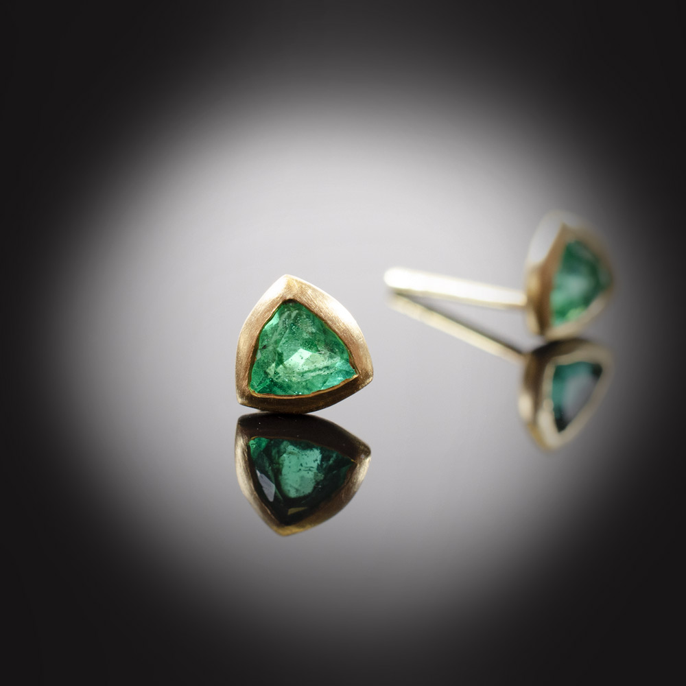 18K brushed yellow gold stud earrings with bezel set Emeralds