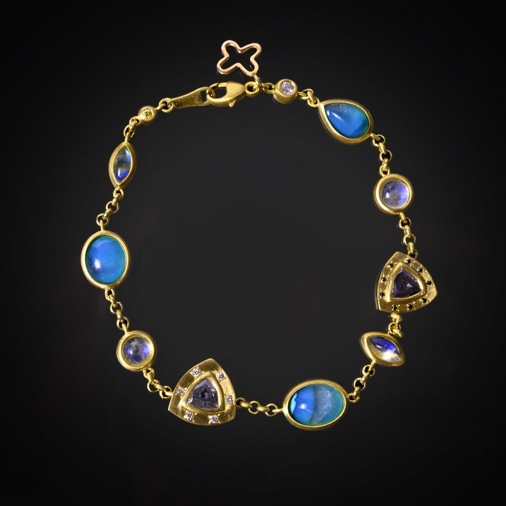 18K brushed yellow gold bracelet with bezel set Gem Silica, grey, black and colorless Diamonds and Moonstones
