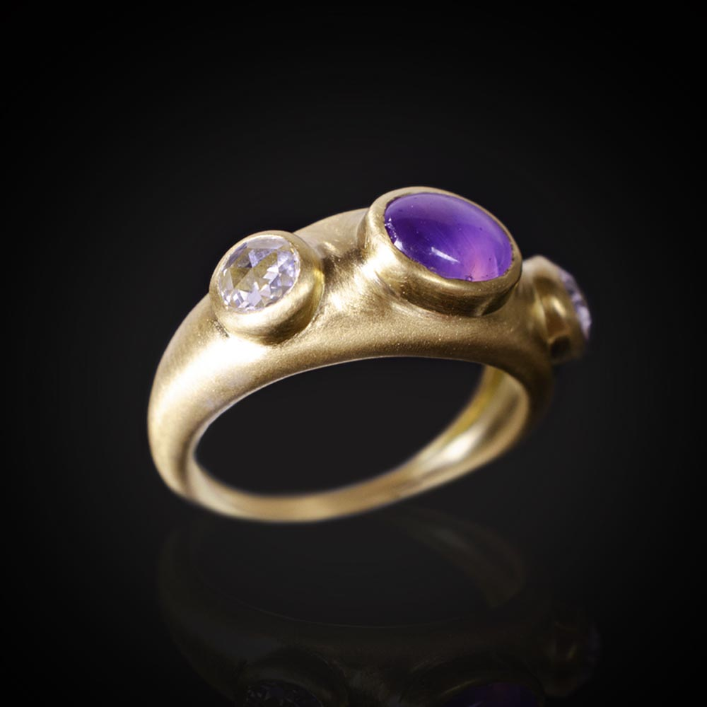 18K brushed yellow gold ring with a 1.69ct star purple Sapphire and colorless rose cut Diamonds